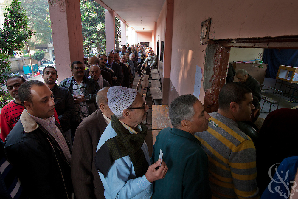 Egyptian voters cue in a line as they wait to take part in a historic free parliamentary election Nov 28, 2011 in the Shubra district of the capital, Cairo. The first round of voting (1 of three) for the election, the first since the revolution in Egypt that ousted former president Hosni Mubarak earlier in the year, saw very high voter turnout and is hoped to be a positive step in the direction of a new democratic spirit for the country. (Photo by Scott Nelson)