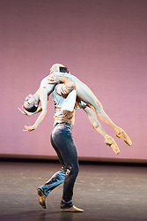© Licensed to London News Pictures. 14/11/2013. Finding Light, choreographed by Edwaard Liang, is danced by San Francisco principal dancers Yuan Yuan Tan and Damian Smith. Also featuring Wheeldon's Five Movements, Three Repeats and Russell Maliphant's new solo work – PresentPast. The evening also features two seminal works - Wheeldon's After the Rain and Maliphant's Two x Two. Pictures shows Five Movements, Three Repeats, featuring Damian Smith and Yuan Yuan Tan. Photo credit: Tony Nandi/LNP.