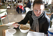 Kelly Ware studies while she eats lunch at O.U.'s new Baker Center on Tuesday, 1/08/07.