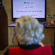 MANASSAS, VA - NOV21:  Sandra Boletchek sings karaoke at Birmingham Green, an elder care residence in Manassas, VA, November 21, 2014. With the U.S. population aging and Alzheimer's more widespread, science is looking for ways to slow or delay the onset of dementia in aging Americans. Among the approaches is trying to determine whether art, music and dance or movement can also alleviate the problems attendant with dementia. The federal government is funding a study at Birmingham Green with George Mason University to see whether there is a scientific basis to believe that art is actually medically beneficial. (Photo by Evelyn Hockstein/For The Washington Post)