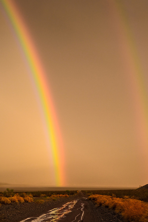 Double helix rainbow appears over the dry Soda Lake of Mojave National Preserve.