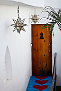 "SHOT 1/18/10 11:09:01 AM - Located on Calle Jose-Mariscal in Sayulita Mexico, Petit Hotel d'Hafa is a quaint boutique hotel just steps away from the Sayulita plaza and less than a two minute stroll to the beach and surfing break. Each of the rooms is individually decorated with art and handicrafts carefully selected from different cultural areas of Mexico. Sayulita is a small fishing village about 25 miles north of downtown Puerto Vallarta in the state of Nayarit, Mexico, with a population of approximately 4,000. Known for its consistent river mouth surf break, roving surfers ""discovered"" Sayulita in the late 60's with the construction of Mexican Highway 200. In recent years, it has become increasingly popular as a holiday and vacation destination, especially with surfing enthusiasts and American and Canadian tourists. (Photo by Marc Piscotty / © 2009)"