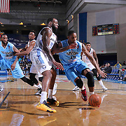 Delaware 87ers Forward Rahlir Hollis-Jefferson (15) drives towards the basket as Texas Legends Forward Damion James (15) defends in the first half of a NBA D-league regular season basketball game between the Delaware 87ers and the Texas Legends (Dallas Mavericks) Sunday, Jan. 25, 2015 at The Bob Carpenter Sports Convocation Center in Newark, DEL
