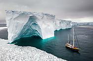 Sailing through enormously huge icebergs near Melchior islands in Antarctica