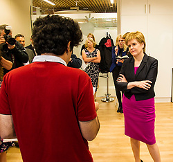 Pictured: the First Minister met Rameez (red t-shirt) and other young people who have benefitted from the help provided by the centre.<br /> <br /> The First Minister Nicola Sturgeon, MSP, joined people supported by the Thistle Foundation to bury a time capsule to mark the opening of a new health and social care centre. <br /> Ger Harley | EEm 14 June 2016
