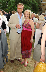TV presenter MARIELLA FROSTRUP and her husband JASON McCUE at the annual House of Lords v House of Commons tug of war match in aid of  of  Macmillan Cancer Relief on 21st June 2005.  A drinks reception was held in College Gardens followd by the tug of war on Victoria Tower Gardens, London.                                 <br />