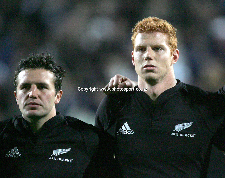 All Blacks Aaron Mauger and James Ryan stand in line for the national anthem during the All Blacks v Fiji Test match played at Albany Stadium, New Zealand, on Friday 10 June, 2005. The All Blacks won the match 91-0. Photo: Andrew Cornaga/PHOTOSPORT<br />