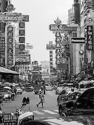 A man crosses a busy street in the Chinatown neighborhood of Bangkok, Thailand, on April 25, 2015.