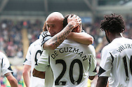 Swansea city's Jonathan De Guzman celebrates with Jonjo Shelvey after scoring his sides 1st goal.<br /> Barclays premier league match , Swansea city v Norwich city at the Liberty stadium in Swansea, South Wales on Saturday 29th March 2014.<br /> pic by Phil Rees, Andrew Orchard sports photography.