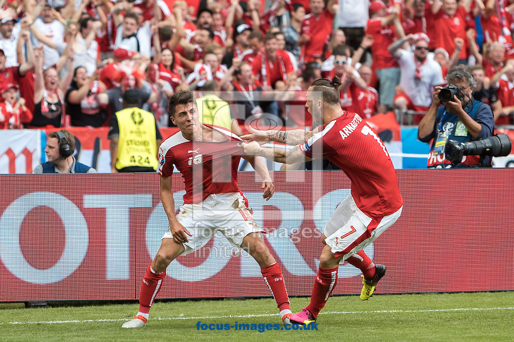 Alessandro Schoepf (left) of Austria celebrates his goal during the UEFA Euro 2016 match at Stade Velodrome, Marseille, France.<br /> Picture by EXPA Pictures/Focus Images Ltd 07814482222<br /> 22/06/2016<br /> *** UK &amp; IRELAND ONLY ***<br /> EXPA-FEI-160622-5043.jpg