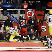 Oregon Duck QB Marcus Mariota scores a 4th Quarter TD, while in the foreground his starting TE Pharoah Brown lays injured.  The University of Oregon Ducks defeated the University of Utah Utes 51-27 at Rice-Eccles Stadium, Salt Lake City, Utah. Photo by Barry Markowitz, 11/8/14, 8pm