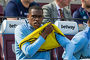 Issa Diop (West Ham) on the bench ahead of the Premier League match between West Ham United and Leicester City at the London Stadium, London, England on 20 April 2019.