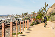 A Biker Riding Along the San Clemente Beach Trail at North Beach