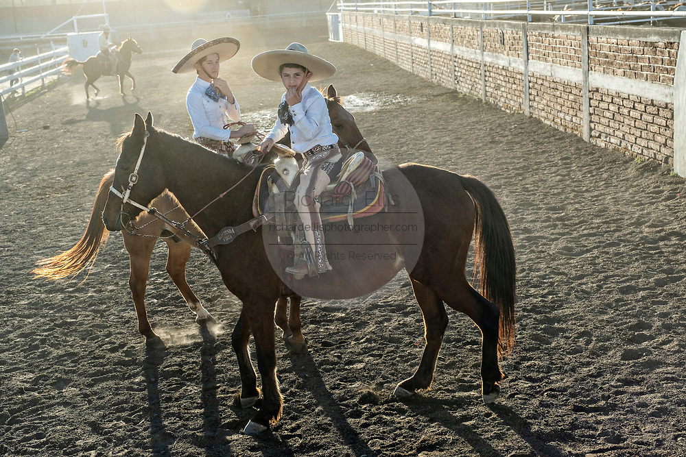 Luis Alfonso Franco, Jr., center, and his cousin Juan Franco, Jr. on horseback at the family Charreria practice session in the Jalisco Highlands town of Capilla de Guadalupe, Mexico. The Franco family has dominated Mexican rodeo for 40-years and has won three national championships, five second places and five third places.