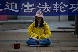 © Licensed to London News Pictures.<br /> 20/07/2020.  London, UK. A group of peaceful protesters of Falun Gong community in London, appeared in front of Chinese Embassy to mark 21st anniversary of what they say the start of the state run prosecution of Falun Gong community.They also state that China kills millions of innocent meditators to sell their organs. Experts estimate 60,000 to 100,000 organs are transplanted annually from prisoners of conscience. Photo credit: Marcin Nowak/LNP