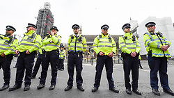 "© Licensed to London News Pictures. 23/04/2019. LONDON, UK. Large numbers of police stand outside the Houses of Parliament awaiting the arrival of activists to Parliament Square during ""London: International Rebellion"", on day nine of a protest organised by Extinction Rebellion.  Protesters are demanding that governments take action against climate change.  Police have issued a section 14 order for Parliament Square and expect that the occupation of the square will have concluded by the end of the day.  Photo credit: Stephen Chung/LNP"