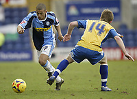 Photo: Aidan Ellis.<br /> Mansfield Town v Wycombe Wanderers. Coca Cola League 2. 24/02/2007.<br /> Wycombe's Lionel Ainsworth (L) goes past Mansfield's Bryan Hodge