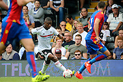 Fulham striker, Floyd Ayite dribbling during the Pre-Season Friendly match between Fulham and Crystal Palace at Craven Cottage, London, England on 30 July 2016. Photo by Matthew Redman.