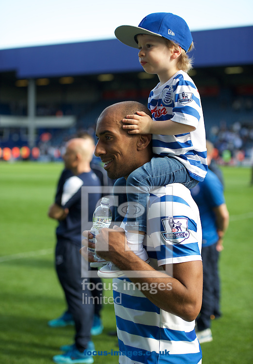 Karl Henry of Queens Park Rangers dwith his child after the Barclays Premier League match at the Loftus Road Stadium, London<br /> Picture by Alan Stanford/Focus Images Ltd +44 7915 056117<br /> 16/05/2015