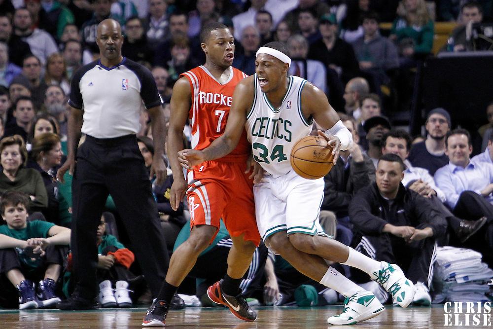 06 March 2012: Boston Celtics small forward Paul Pierce (34) drives past Houston Rockets point guard Kyle Lowry (7) during the Boston Celtics 97-92 (OT) victory over the Houston Rockets at the TD Garden, Boston, Massachusetts, USA.
