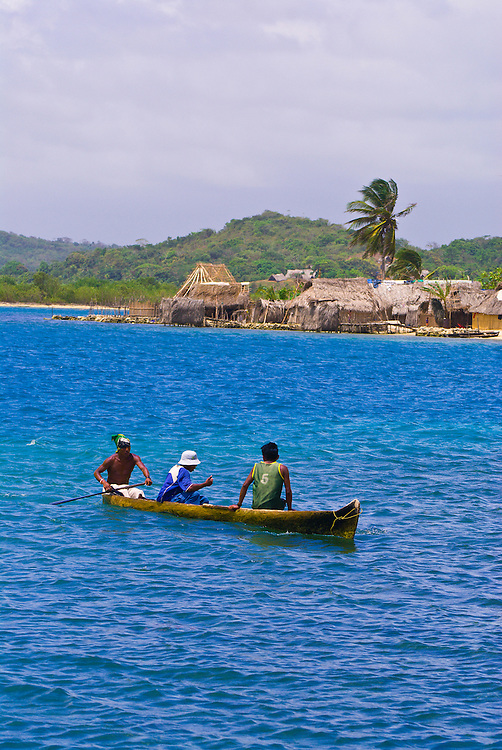 Dugout canoe with Kuna Indian village in background, San Blas Islands (Kuna Yala), Caribbean Sea, Panama