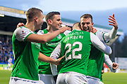 Christian Doidge (#9) of Hibernian FC is mobbed by his team mates after scoring Hibs fourth goal to give him a hat-trick during the Ladbrokes Scottish Premiership match between St Johnstone FC and Hibernian FC at McDiarmid Park, Perth, Scotland on 9 November 2019.