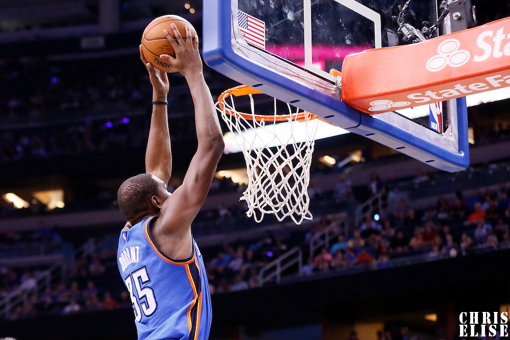 30 October 2015:  Oklahoma City Thunder forward Kevin Durant (35) goes for the dunk during the Oklahoma City Thunder 139-136 double overtime victory over the Orlando Magic, at the Amway Center, in Orlando, Florida, USA.