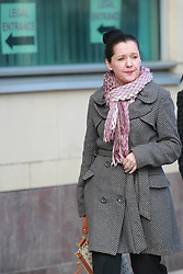 Aine Adams, daughter of Liam Adams, leaves Belfast Crown Court after her father, the younger brother of Sinn Fein president Gerry Adams, was found guilty of a string of child sex abuse charges at the start of Oct, 2013, Northern Ireland, Tuesday, 5th November 2013. Picture by Paul McErlane / i-Images