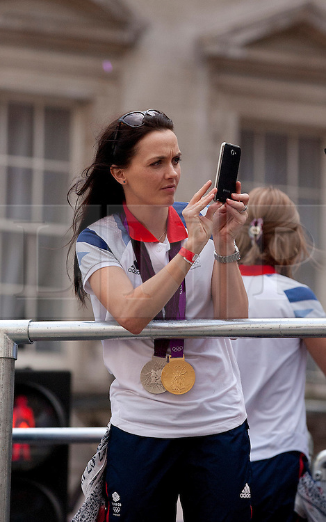 © Licensed to London News Pictures. 10/09/2012. LONDON, UK. Wearing her gold and Silver medals, cyclist Victoria Pendelton takes pictures of spectators near Bank Station during a parade for British Olympic and Paralympic athletes in London today (10/09/12). Photo credit: Matt Cetti-Roberts/LNP.