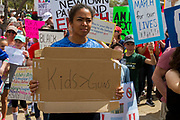 A student holds a home made sign during the March for our Lives event in front of Dallas City on Saturday to protest for gun reform.