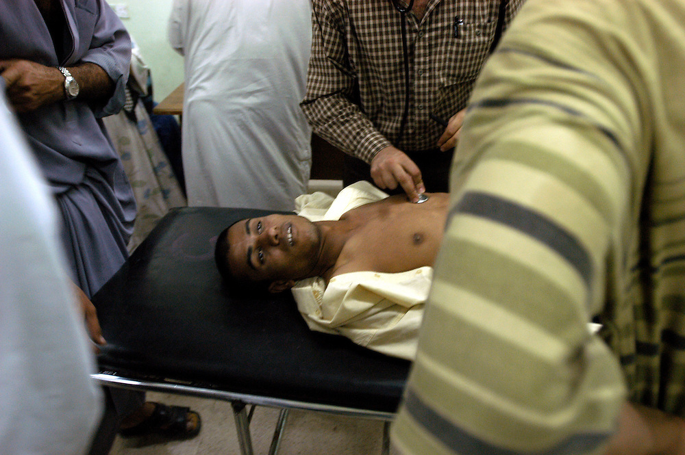 A young man dead on arrival with a bullet in his chest at the al-Kadisia Hospital emergency room in Thora City, formerly known as Saddam City. The area is a vast slum of 3 million Shiite Muslims, long oppressed and marginalized by Saddam's regime. The neighborhood is a hotbed for the insecurity and violence that has thrived with the absence of authority in the country..Baghdad, Iraq. 06 May 2003..Photo © J.B. Russell