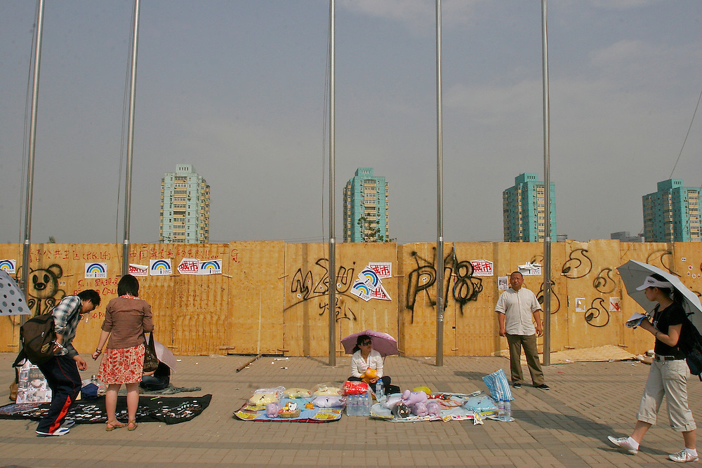 Vendors sit alongside the entrance of the Midi Music Festival in Beijing China 2007.  Midi is a Chinese rock concert that lasts 4 days and features local and international bands.
