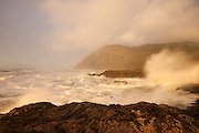 Pacific Ocean waves slam against the rugged coastline at Cape Perpetua near Yachats, Oregon.
