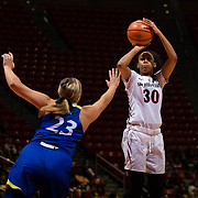 24 February 2018: The San Diego State women's basketball team closes out it's home schedule of the regular season Saturday afternoon against San Jose State. San Diego State Aztecs guard Cheyenne Greenhouse (30) attempts a shot while being defended by San Jose State Spartans forward Mikaylah Wilson (32) in the first half.  At halftime the Aztecs lead the Spartans 36-33 at Viejas Arena.<br /> More game action at sdsuaztecphotos.com