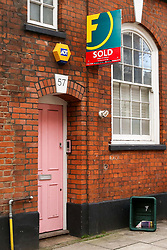 © Licensed to London News Pictures. 23/12/2019. London, UK. A 'SOLD' sign outside Radio presenter and Love Island host CAROLINE FLACK'S  flat in Islington, North London where she was arrested and charged following an alleged row with her boyfriend LEWIS BURTON on Thursday 12 December. Early today she pleaded not guilty at Highbury Corner Magistrates' Court and will appear before a Crown Court in March for a jury trail. Photo credit: Dinendra Haria/LNP