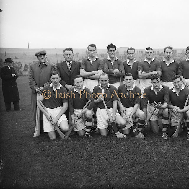 National League GAA Hurling at Croke Park Cork V. Dublin..15.11.1953  15th November 1953.<br /> <br /> 6. There shall be an umpire for each side and a referee who will decide in cases where the umpires disagree. The referee keeps the time and throws up the ball at the commencement of each goal.<br /> 7. The time of play shall be one hour and twenty minutes. Sides to be changed at half–time.<br /> 8. Before commencing play hurlers shall draw up in two lines in the centre of the field opposite to each other and catch hands or hurleys across, then separate. The referee then throws the ball along the ground between the players or up high over their heads.<br /> 9. No player to catch, trip or push from behind. Penalty, disqualification to the offender and free puck to the opposite side.<br /> 10. No player to bring his hurley intentionally in contact with the person of another player. Penalty same as in Rule 9.<br /> 11. If the ball is driven over the side-line it shall be thrown in towards the middle of the ground by the referee or one of the umpires; but if it rebounds into the ground it shall be considered in play.<br /> 12. If the ball is driven over the end-lines and not through the goal, the player who is defending the goal shall have a free puck from the goal. No player of the opposite side to approach nearer than twenty yards until the ball is struck. The other players to stand on the goal-line. But if the ball is driven over the goal-line by a player whose goal it is, the opposite side shall have a free puck on the ground twenty yards out from the goalposts. Players whose goal it is to stand on the goal–line until the ball is struck. NB: Hitting both right and left is allowable.