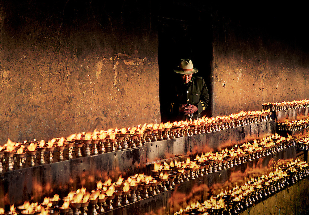 Tibetan Buddhist devotional butter lamps. The Jokhang Temple. Lhasa, Tibet