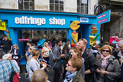 Busy street outside Edfringe official ticket office and shop on High Street in Edinburgh during Fringe Festival 2016,Scotland, United Kingdom