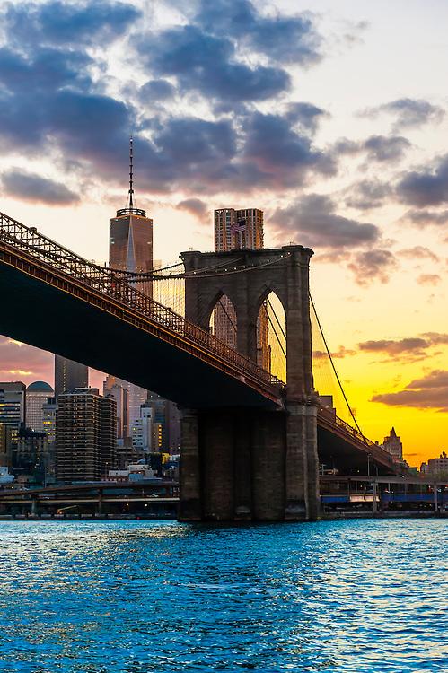 Manhattan Bridge at sunset, East River, New York, New York USA.
