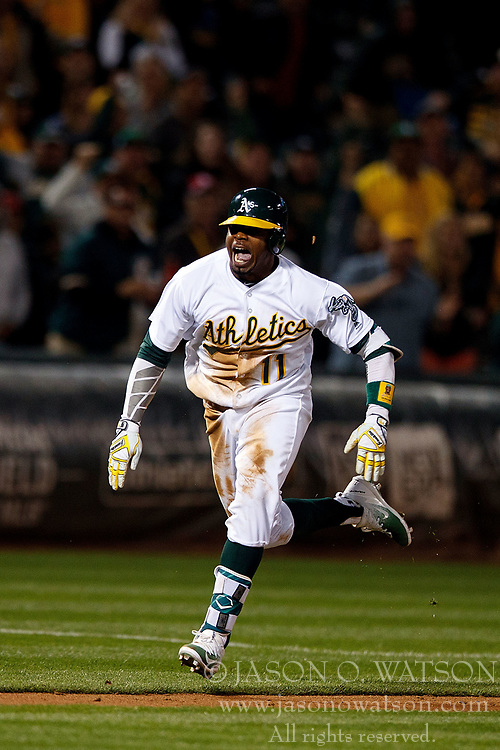 OAKLAND, CA - APRIL 04:  Rajai Davis #11 of the Oakland Athletics scores a run against the Los Angeles Angels of Anaheim during the seventh inning at the Oakland Coliseum on April 4, 2017 in Oakland, California. The Los Angeles Angels of Anaheim defeated the Oakland Athletics 7-6. (Photo by Jason O. Watson/Getty Images) *** Local Caption *** Rajai Davis