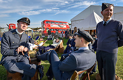 **CAPTION CORRECTION. Picture originally sent with wrong date. Picture was taken TODAY 11/09/2015** © licensed to London News Pictures. 11/09/2015<br /> Goodwood Revival Weekend, Goodwood, West Sussex. UK.<br /> The Goodwood Revival is the world's largest historic motor racing event. Competitors and enthusiasts dress in period fashions recreating the glorious days of the race circuit.<br /> Pictured Members from the Battle of Europe Living Historians group dress in period RAF uniform.<br /> <br /> Photo credit : Ian Whittaker/LNP