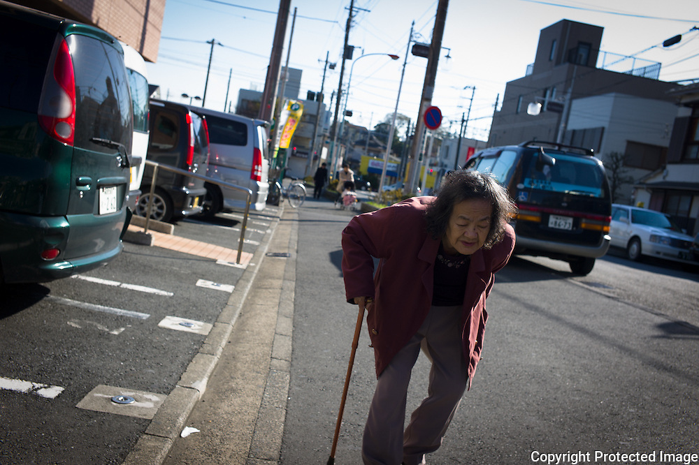 Old lady walking in Japan