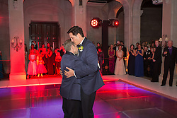 two gay men dancing at their wedding