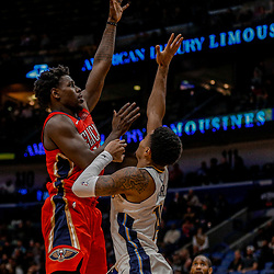 Dec 6, 2017; New Orleans, LA, USA; New Orleans Pelicans guard Jrue Holiday (11) shoots over Denver Nuggets guard Gary Harris (14) during the second half at the Smoothie King Center. The Pelicans defeated the Nuggets 123-114. Mandatory Credit: Derick E. Hingle-USA TODAY Sports
