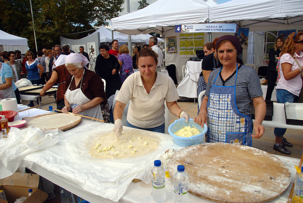 Traditional cheese-pie making at the 5th Panhellenic Feta Cheese Festival at Elassona town, Larissa Prefecture, Thessaly, Central Greece. Feta is a brined curd cheese traditionally made in Greece and has been recognized as a protected designation of origin product since 2002.<br /> <br /> Traditional music and dance, concerts, cheese pies and junketing, scientific speeches and bicycle acrobatics, chess games and political presences, delicious dairy products, local traditional varieties of seeds and products of organic farming, this year's Festival of feta cheese had something for everyone from the 25th until the 27th of September in the beautifully decorated town of Elassona in central Greece.