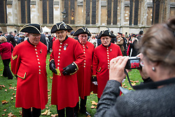 © Licensed to London News Pictures. 04/11/2015. London, UK. A group of Chelsea pensioners pose for a photograph before a service to mark the opening of the Filed of Remembrance at Westminster Abbey, attended by Prince Philip, Duke of Edinburgh and Prince Harry.  The Field of remembrance is a memorial garden to commemorate British and Commonwealth military and civilian servicemen and women in the two World Wars and later conflicts. Photo credit: Ben Cawthra/LNP
