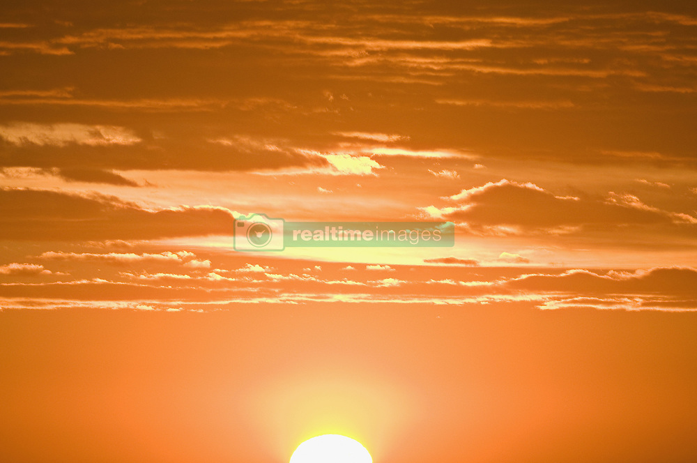 Jun. 20, 2009 - A sun setting against an orange sky. Not Released (NR) (Credit Image: © Cultura/ZUMAPRESS.com)