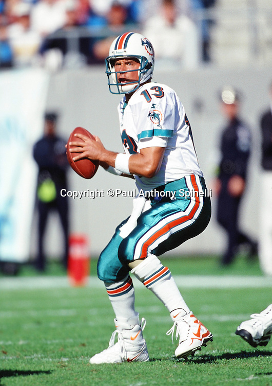 Miami Dolphins quarterback Dan Marino (13) throws a pass during the NFL football game against the Carolona Panthers on Nov. 15, 1998 in Charlotte, N.C. The Dolphins won the game 13-9. (©Paul Anthony Spinelli)