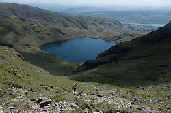 © London News Pictures. 23/05/15. Cumbria, UK. Walkers climb the Old Man of Coniston, Cumbria. Photo credit: Laura Lean/LNP