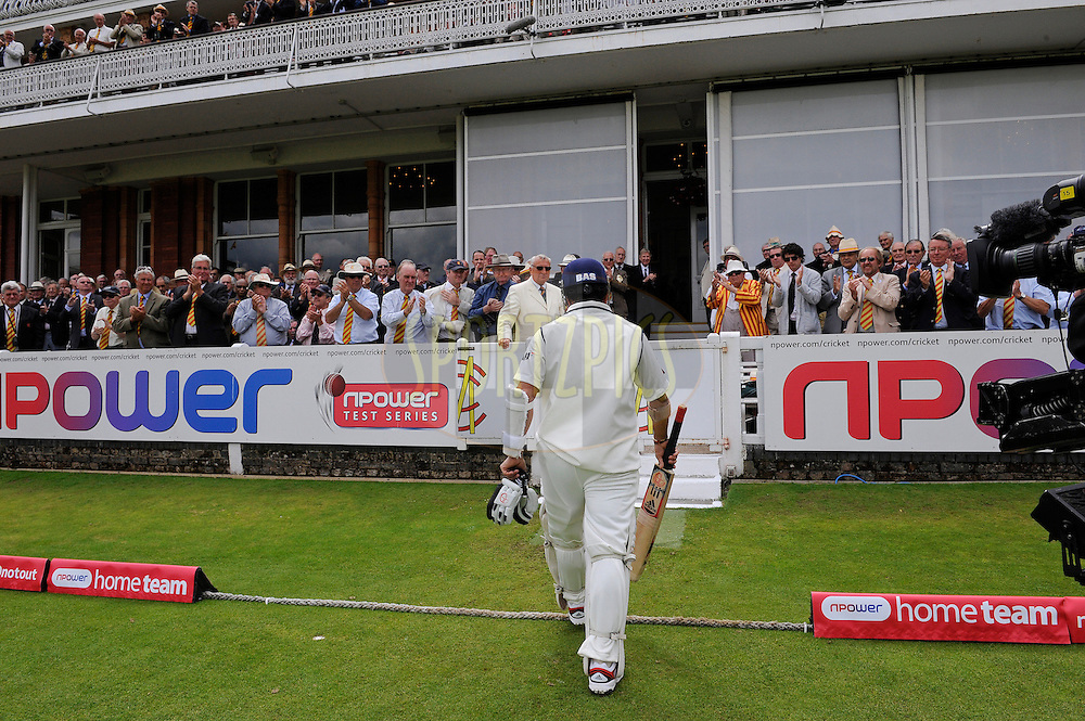 England v India, 1st test match, day three, Lords cricket ground, London. 23/7/11. Pic: Tom Jenkins..Sachin Tendulkar walks off after being dismissed for 34 caught Swann bowled Broad.